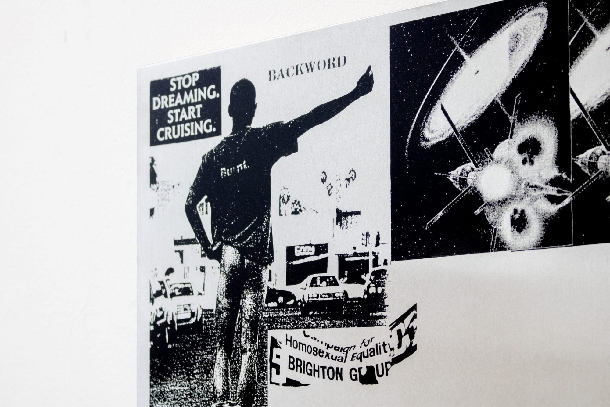 """Detail of the main Periploi image. On a white background, a light metallic surface viewed from an angle contains black and white printed images. The words """"Stop Dreaming. Start Cruising."""" , """"Backword"""" and """"Campaign for Homosexual Equality Brighton Group"""" can be read along the top and bottom. A male figure stands facing away with their trousers round their ankles, thumbing a lift. To the right is a pixelated image of a space satellite against a faraway galaxy."""