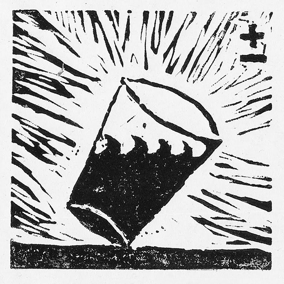 A square black and white linocut print, contained in a blank white border depicts a cup sat on a flat surface filled with liquid tilted and balanced to the right. Inside the cup the liquid produces a wave. Around the cup are thin black lines pointing away from the cup made by the lino cutting process.
